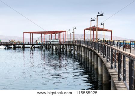 pier with wooden decking on a cloudy day