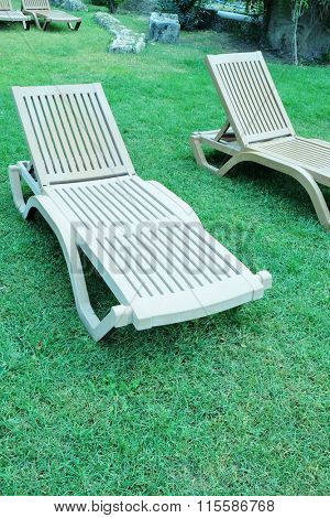 Chaise longues on the garden grass