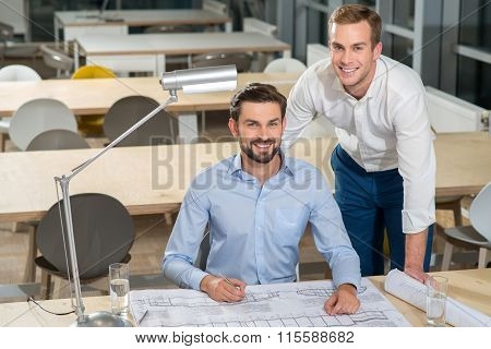 Handsome young businessmen are discussing new plan