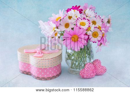 Daisy flowers and gift.