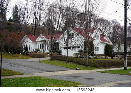 White Harbor Springs Home with a Red Roof