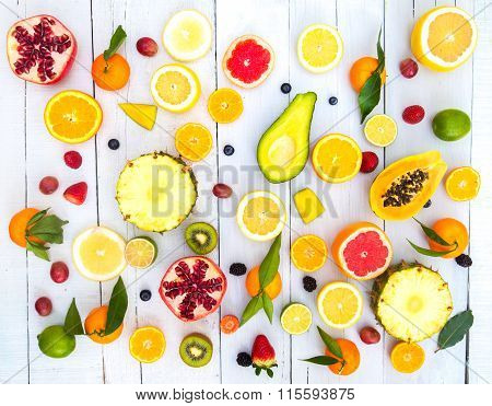 Colored Fruits On White Wooden Background