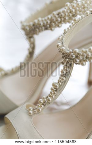 Macro Photo Of White Wedding Shoes Decorated With White Pearls