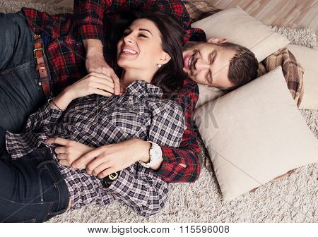 Beautiful Tender Couple In Casual Clothes, Relaxing At Home