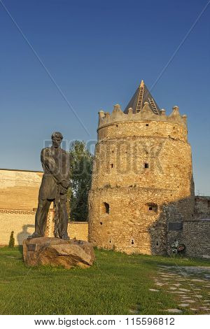 The tower of the caste in Letychiv and the statue of Ustym Karmalyuk - the famous Ukrainian rebel in the 19-th century Ukraine