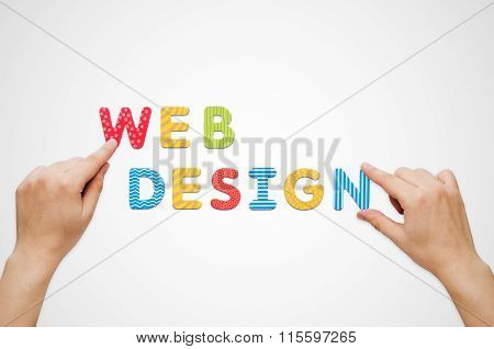 Hands Put The Words Web Design With Magnetic Letters
