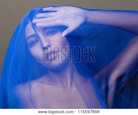 beauty young islamic woman under veil, blue hijab on face close up, art