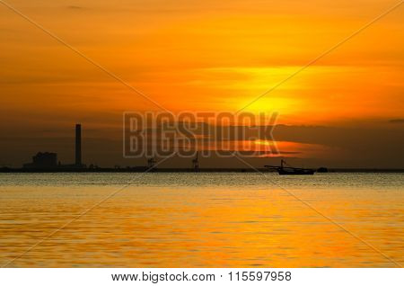 Sunrise Over Sea And Industrial Factory