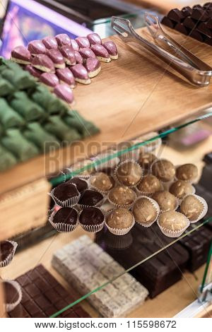 Handmade Chocolate Candies Collection And Chocolates On The Shelf In Healthy Shop