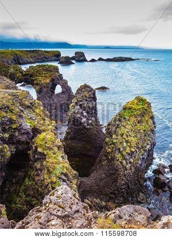 The fantastic coastal cliffs Arnastapi. Travel to Iceland in the summer