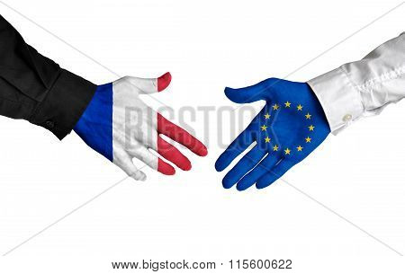 France and European Union leaders shaking hands on a deal agreement