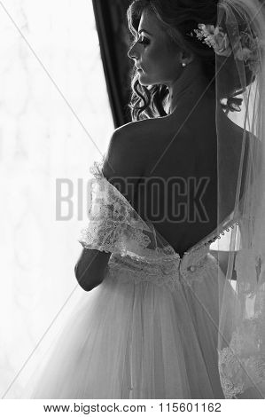 Beautiful Brunette Bride In Elegant White Dress Posing Near Window B&w