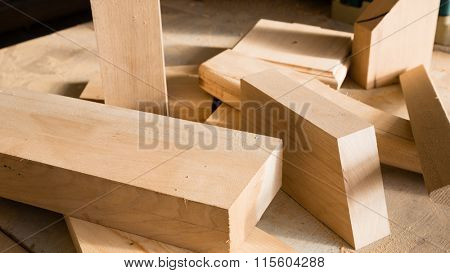 Wooden sticks on a workbench in the carpentry workshop