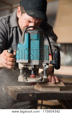 Carpenter working of manual milling machine in the carpentry workshop