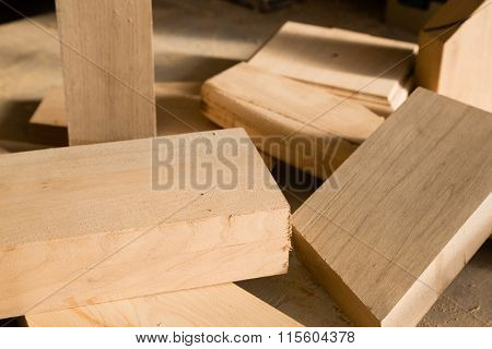 Wood trims lie on a workbench in the carpentry workshop