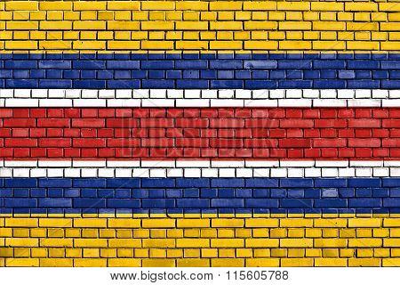 Flag Of Mengjiang Painted On Brick Wall