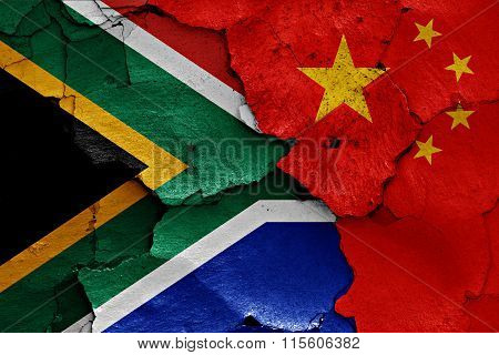 Flags Of South Africa And China Painted On Cracked Wall