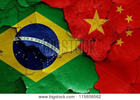 Flags Of Brazil And China Painted On Cracked Wall