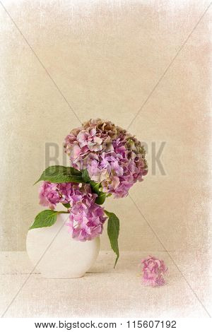 Painterly textured flower still life on old wooden board