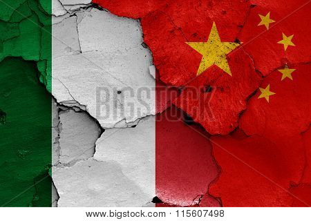 Flags Of Italy And China Painted On Cracked Wall