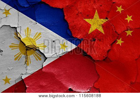 Flags Of Philippines And China Painted On Cracked Wall