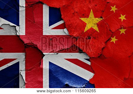 Flags Of Uk And China Painted On Cracked Wall