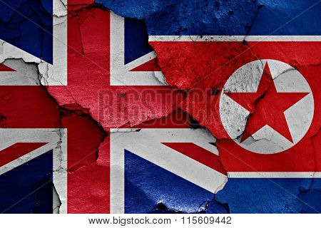 Flags Of Uk And North Korea Painted On Cracked Wall