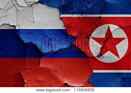 Flags Of Russia And North Korea Painted On Cracked Wall