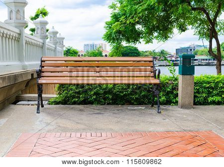 Bench At River Side In The Park