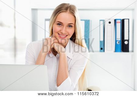 Portrait of a young business woman using computer at office
