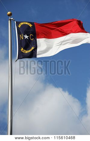 North Carolina State flag waving under sky
