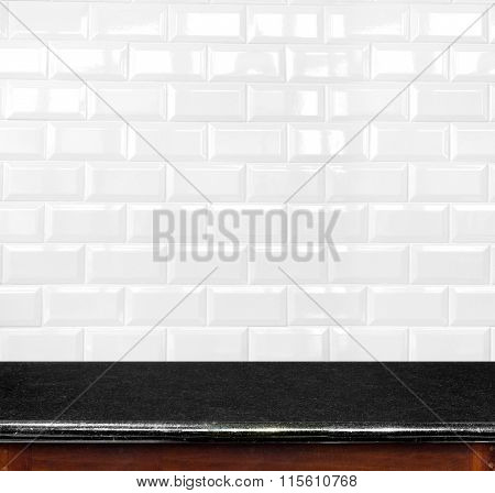 Empty Black Marble Table And Ceramic Tile Brick Wall In Background. Product Display Template.