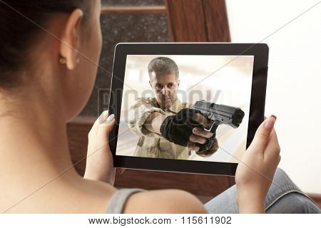 Cropped image of woman looking at action movie on tablet