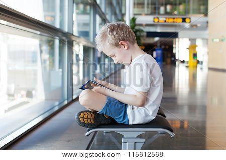 Kid At Airport