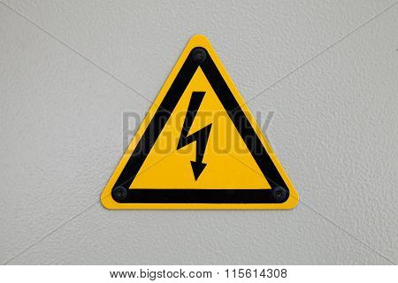 High Voltage Triangle Warning Sign Mounted On Gray