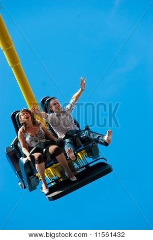 Couple Riding On The Attraction