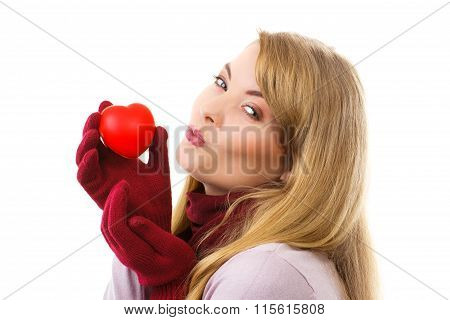 Woman In Woolen Gloves Holding Red Heart And Sending Kiss, Symbol Of Love