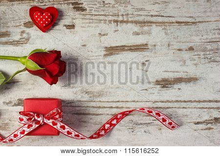 Wrapped Gift With Ribbon, Red Heart And Rose For Valentines Day, Copy Space For Text