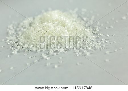 Closeup Of White Granulated Sugar On Isolated White Background