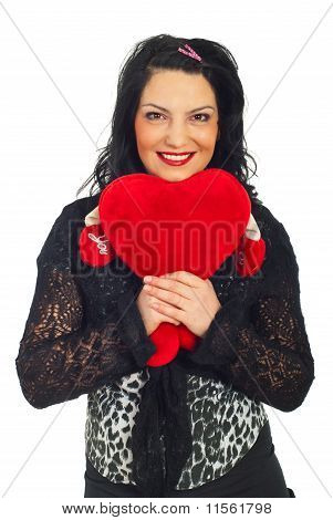 Cute Woman Holding A Heart Toy