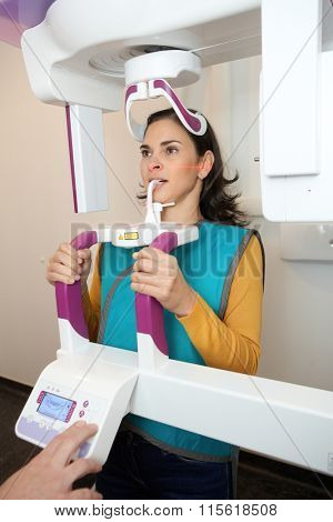 Young woman having dental panoramic x-ray with hightech digital equipment.