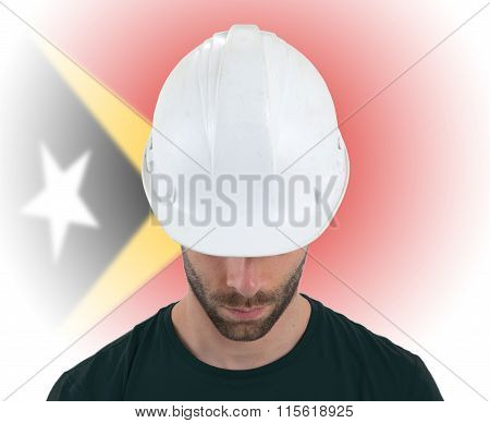 Engineer With Flag On Background - East Timor
