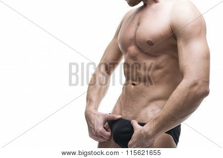 Handsome Muscular Bodybuilder Posing On White Background. High Key Studio Isolated Shot With Copy Sp
