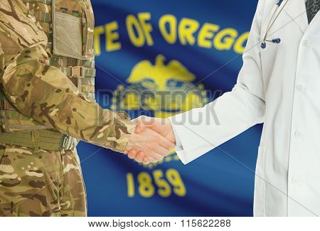 Military Man In Uniform And Doctor Shaking Hands With Us States Flags On Background - Oregon