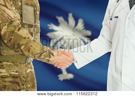Military Man In Uniform And Doctor Shaking Hands With Us States Flags On Background - South Carolina