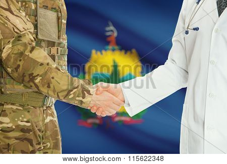 Military Man In Uniform And Doctor Shaking Hands With Us States Flags On Background - Vermont