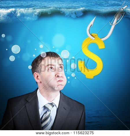 Businessman with inflated cheeks under water