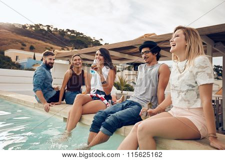 Young People Drinking Cocktails By The Pool