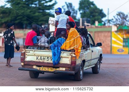 Nairobi, KENYA December 31, 2012: Men, women and children near the car refueling Dec. 31, 2012 in Na
