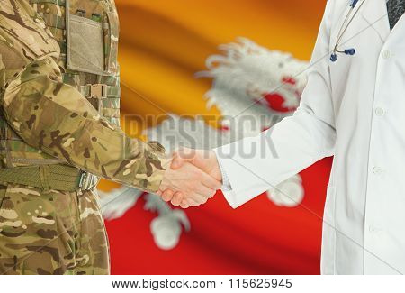 Military Man In Uniform And Doctor Shaking Hands With National Flag On Background - Bhutan